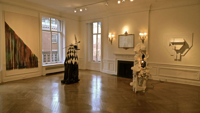 The space during the day-time. From the left: a textile work by Carolyn Salas; Windham's sculpture; Andy Ness's All Dressed Up and Nowhere to Go; Rory Baron's Electrician installation on the wall.